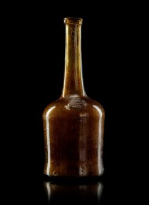 A glass wine bottle, marked 'CON STANTIA WYN', South Africa 18th/19th Century. Image from The Spring Classic Sale, Stockholm 574 Bukowskis Market.