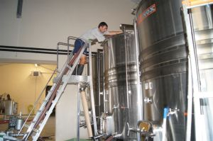 Sebastien Working in the Winery. Image from Ch. Juvenal.