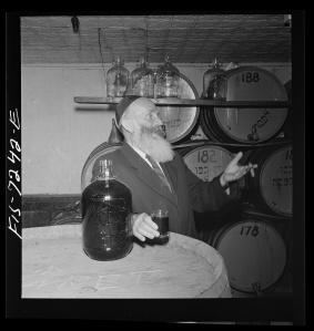Rabbi in a kosher wine shop in the New York's Jewish section. 1942. [1]