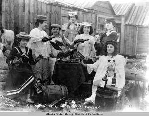 """A drinking """"bee"""" at White Chapel, Dawson. ca 1899. Alaska State Library.  [1]"""